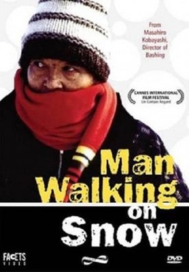 THE MAN WALKING ON THE SNOW