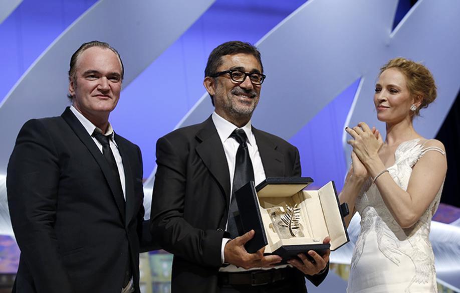 Quentin Tarantino, Nuri Bilge Ceylan et Uma Thurman © AFP / V. Hache